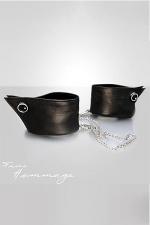 Bracelets Manchettes en Cuir Faire Hommage : Ces bracelets en cuir cachées sous des manchettes se ferment et se transforment en menottes en leur ajoutant une chaine amovible.